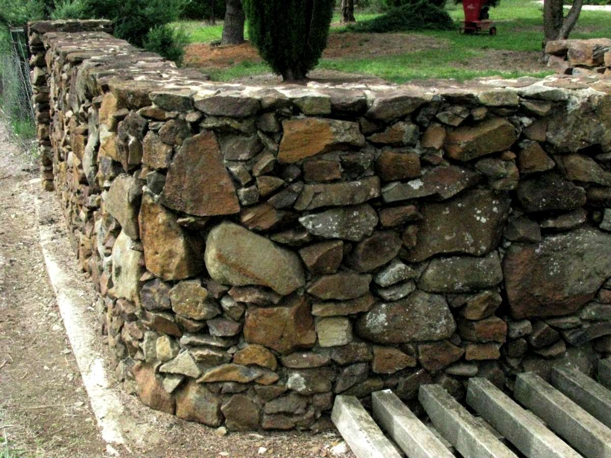 How To Build A Small Stone Wall With River Rock