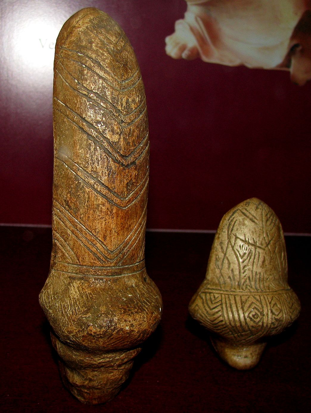 two stylised carvings said to be female figurines