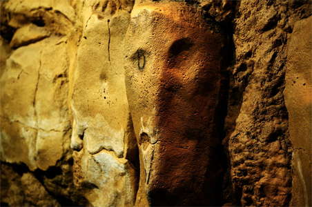 Altamira face on the wall