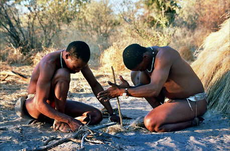 san tribesmen making fire