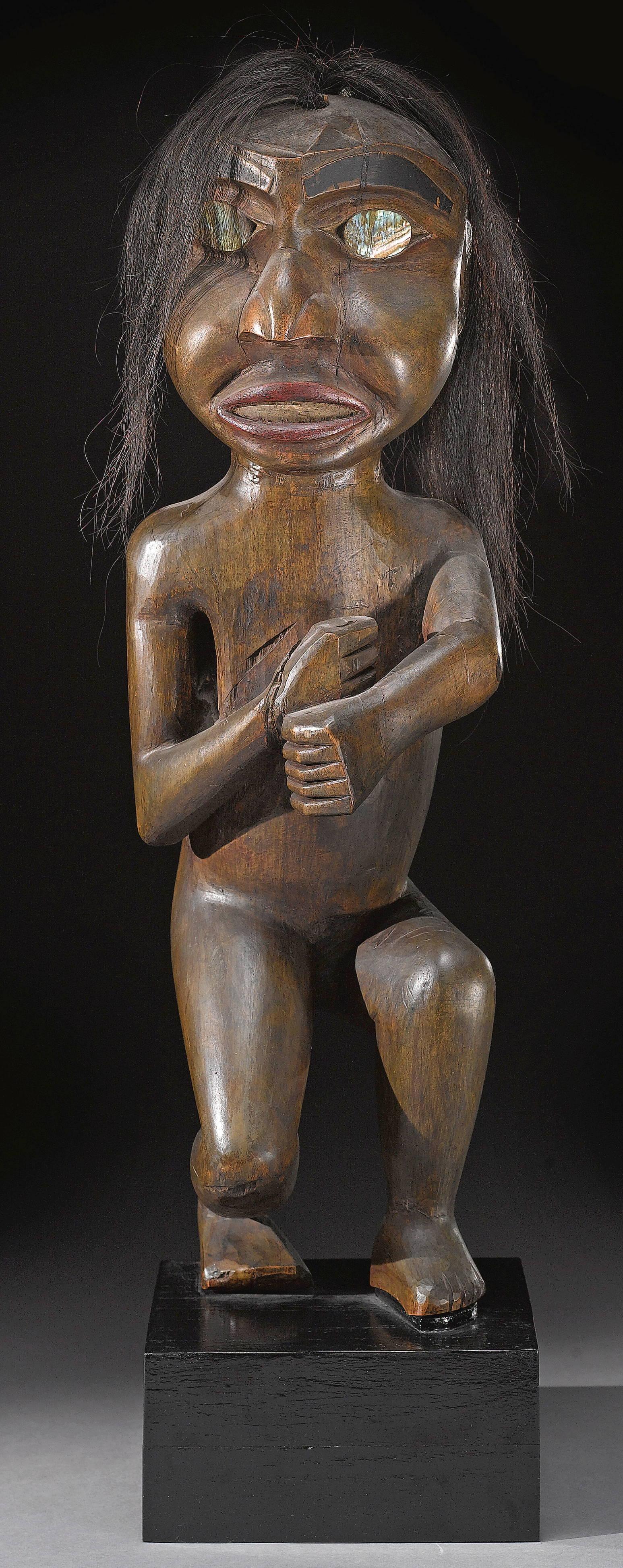 Carved human figure on haida totem pole canada stock photo getty