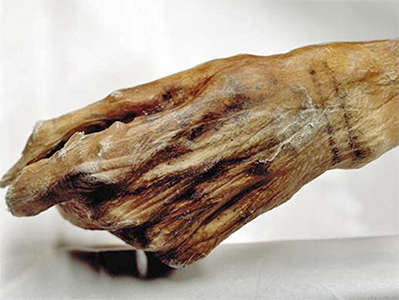 Otzi hand tattoos