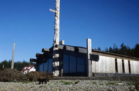 Skidegate totem pole and building
